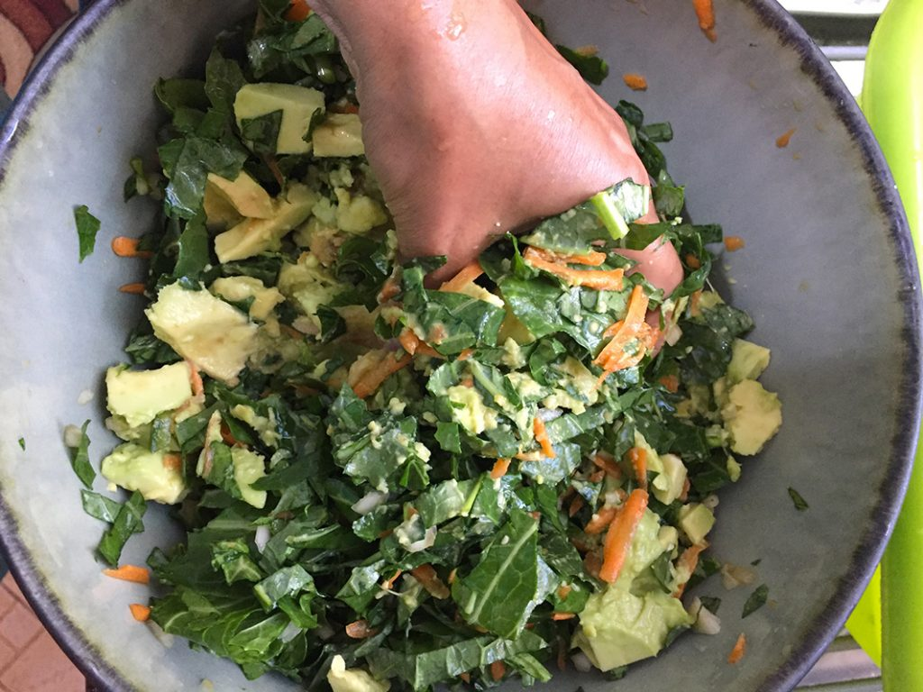 massage the avocado into the collard green salad